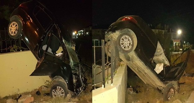 Takla atan otomobil, duvarda asılı kaldı