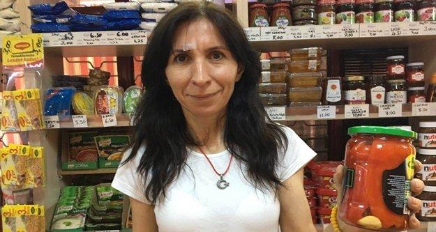Kadın market çalışanından saldırgana kavanoz