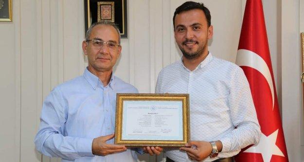 Toklu, ALKÜ'den yüksek lisans diplomasını aldı