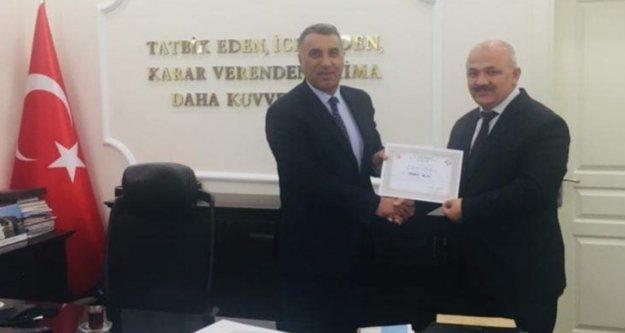 Hasan Akın'a takdir belgesi verdi