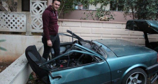 İkiye bölünen araçtan yara almadan kurtuldu