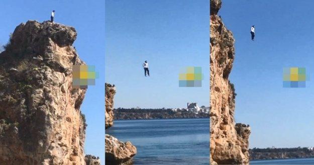 Elbiseleriyle 40 metreden denize atladı, izleyenler de alkışladı