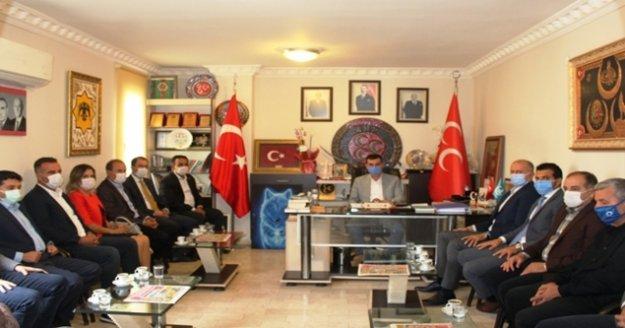 AK Parti'li meclis üyelerinden MHP'ye ziyaret
