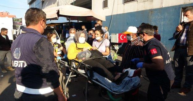 Pazar alışverişi sırasında silahlı kavganın arasında kalan kadın yaralandı