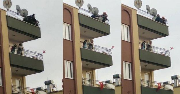 Çatıda intihara teşebbüs eden genç kadının polis tarafından yakalanma anı kamerada