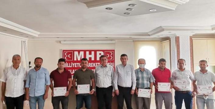 MHP'de mahalle başkanları belgelerini aldı