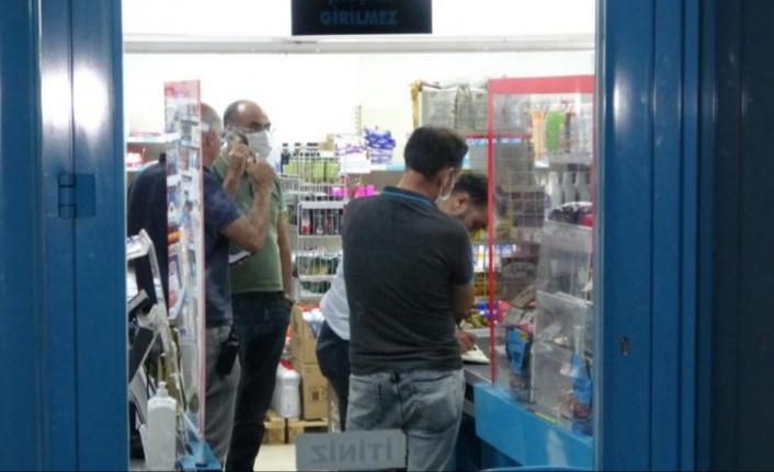 Zincir market şubesinde maskeli silahlı soygun