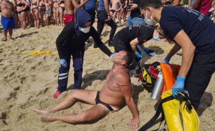 Boğulmak üzere olan turist, cankurtaran ipiyle hayata tutundu