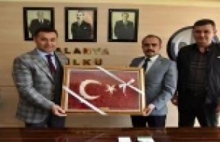 Yücel ve Tükdoğan'dan ocak başkanına hayırlı...