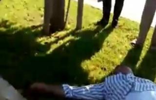 Kaza sonrası acı içerisinde yerde yatan adamı...