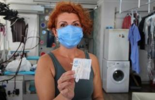 Kuru temizlemeci kadın esnaftan örnek davranış